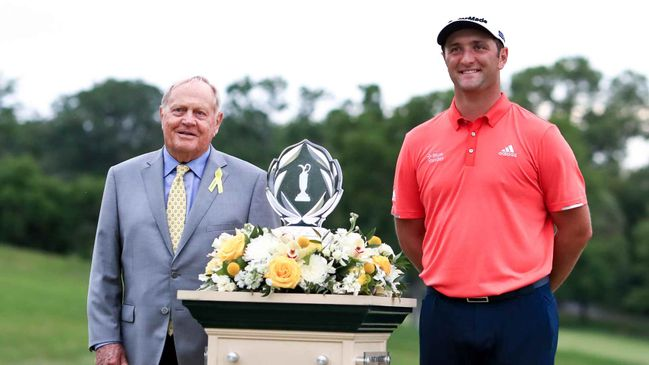Jack Nicklaus (left) presented Jon Rahm with the 2020 Memorial Tournament trophy last year