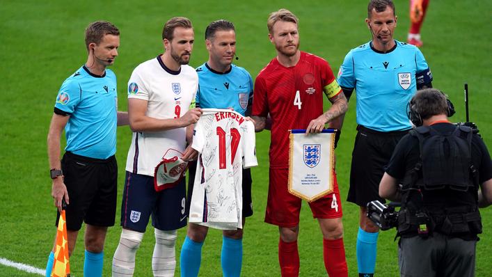 England captain Harry Kane presents Denmark counterpart Simon Kjaer with a signed Christian Eriksen shirt prior to kick-off