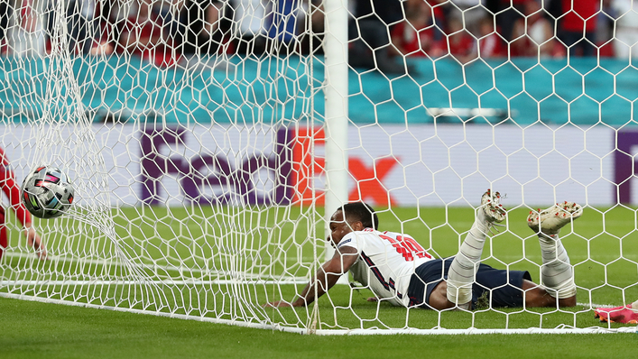 Raheem Sterling follows the ball into the net to drag England level before the break