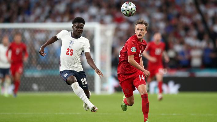 Creator Bukayo Saka and scorer Mikkel Damsgaard battle for possession