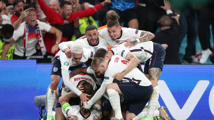 England bundle after captain Harry Kane scores what proved to be the winner at Wembley