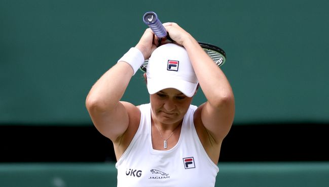 Ash Barty celebrates after beating Angelique Kerber to reach her maiden Wimbledon final
