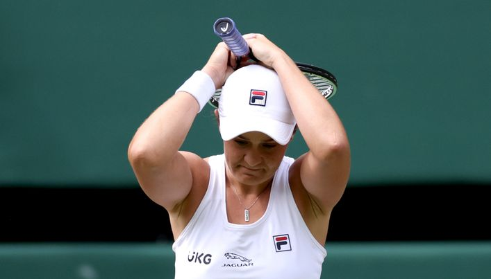 Ash Barty celebrates after reaching the Wimbledon final, where she will face Karolina Pliskova