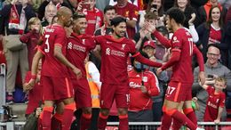 Roberto Firmino celebrates with his teammates after scoring Liverpool's second goal of the evening