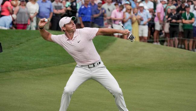 Rory McIlroy tosses his ball into the crowd after winning a third Wells Fargo Championship
