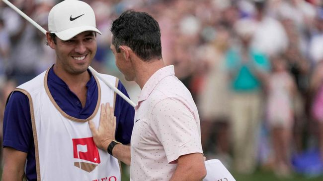Rory McIlroy reserved special praise for his caddie Harry Diamond (left) after a challening closing hole