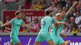 Leandro Trossard (second right) is mobbed by his teammates after scoring a 90th minute winner