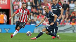 Southampton's Adam Armstrong and West Ham's Tomas Soucek battle for the ball