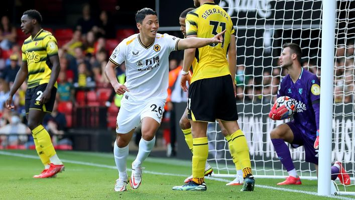 Hwang Hee-chan celebrates after doubling Wolves' advantage