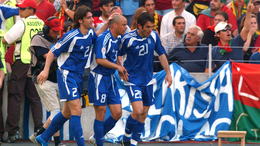 Georgios Karagounis celebrates scoring Greece's opener against Portugal after just six minutes of the tournament's curtain-raiser in 2004