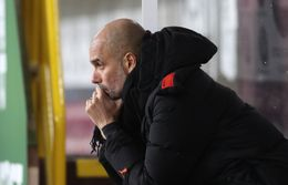 Pep Guardiola has played down talk of winning four trophies