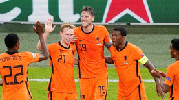 The Netherlands celebrate after Wout Weghorst doubled their lead against Ukraine