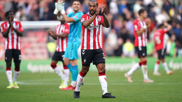 Theo Walcott applauds the fans following Saints' victory over Leeds