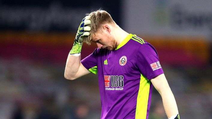 A dejected Aaron Ramsdale trudges off at full-time following Sheffield United's relegation