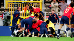 Spain celebrate Alfonso Perez's dramatic late winner against Yugoslavia with a pile-on