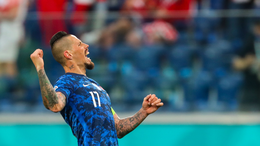 Slovakia skipper Marek Hamsik celebrates his country's win over Poland on matchday one