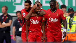 Emmanuel Dennis is congratulated by his teammates following his goal against Norwich