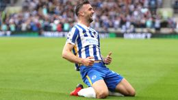 Shane Duffy slides away in celebration after his opening goal
