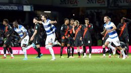 QPR players celebrate their winning penalty against Everton