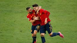 Alvaro Morata and Jordi Alba celebrate the former's goal against Poland