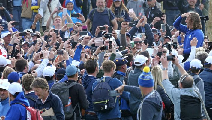 Tommy Fleetwood is head aloft by adoring fans after Europe won in France three years ago