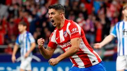 A late brace from Luis Suarez earned Atletico Madrid a point