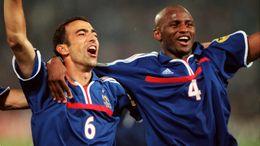 Youri Djorkaeff and Patrick Vieira celebrate winning the Euro 2000 final in Rotterdam