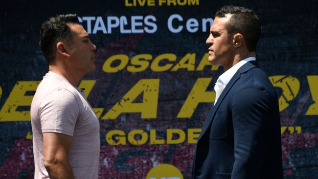 Oscar De La Hoya and Vitor Belfort collide at the Staples Center in Los Angeles on September 11