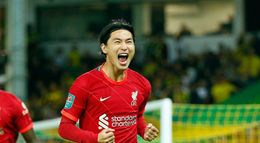 Takumi Minamino celebrates his goal for Liverpool in their Carabao Cup win over Norwich