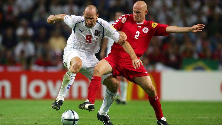 Jan Koller and Denmark's Kasper Bogelund battle for the ball at Euro 2004