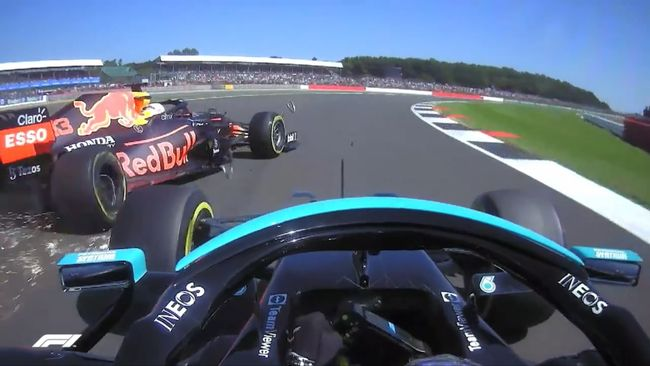 Max Verstappen's Red Bull is propelled off the track after colliding with Lewis Hamilton's Mercedes at Silverstone